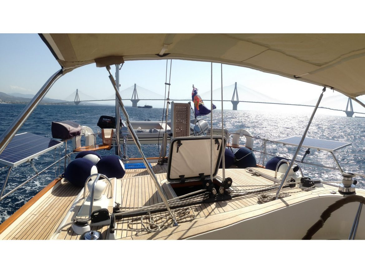 Dinghy on davits, solar panels out
